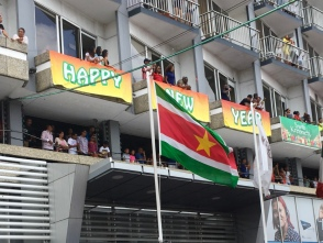 Suriname's flag proudly waves.