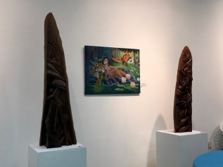 The ornately carved pieces hewn from tropical timber and the rainforest-themed painting make this Suriname in a snapshot.